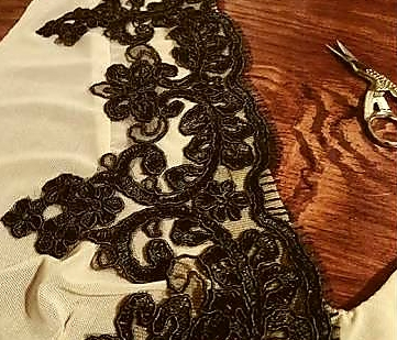 Black lace trim being placed on edge