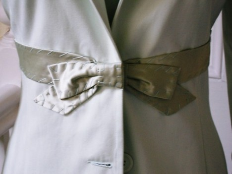 Soft mint silk satin bow detail on women's dress coat