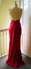 Red silk satin cut away back gown