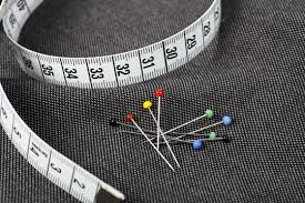 Cloth, Pins and tape measure