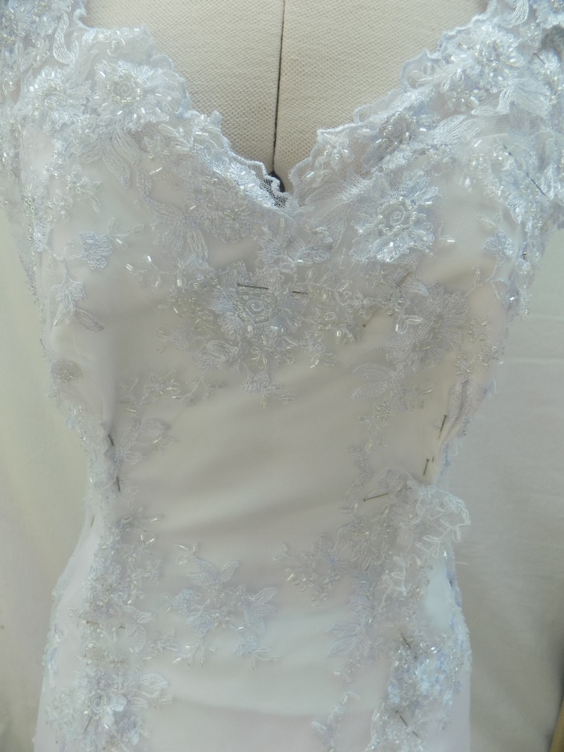 Heavierly beaded and lace detailing to Wedding Gown alteration high quality wedding gown alterations by Kate Henry Designs
