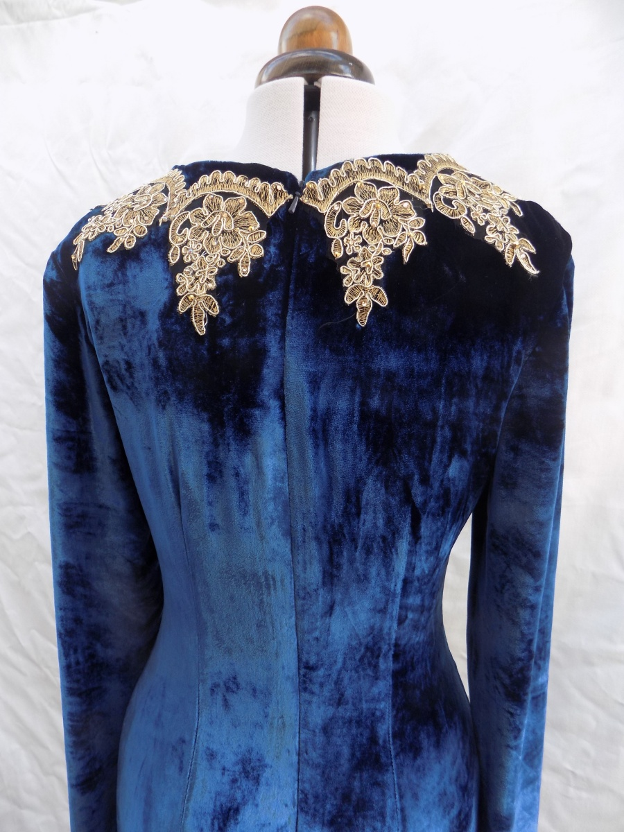 Gold lace work to compliment Navy velvet gown