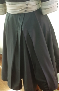 Full skirt with layers and pleats and nipped in at waist