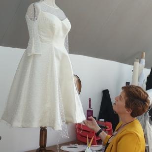 Hand finishing Wedding Gown